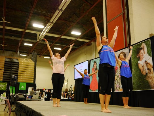 Access Fitness provides a yoga demonstration on the