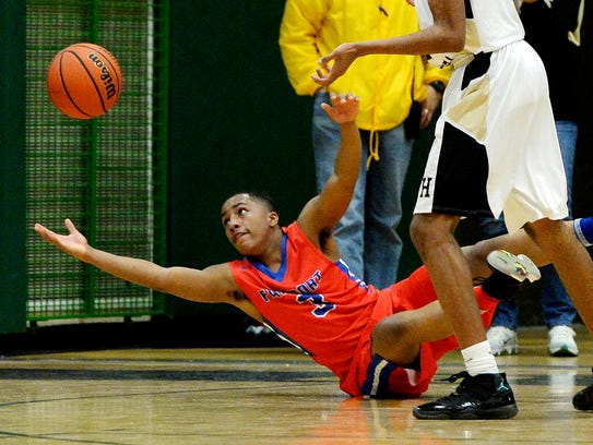 Fairport's Andre Starks reaches for a loose ball during