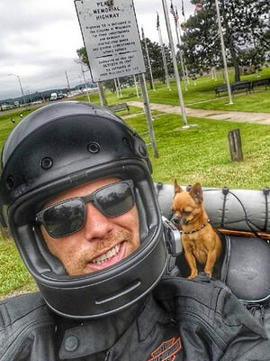 Adam Sandoval and his Chihuahua, Scooter, are riding a Harley Davidson motorcycle across the country to raise money for the families of fallen veterans.