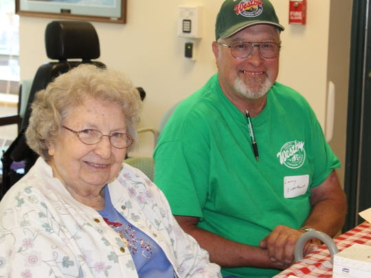 King area farmer Larry Eisentraut swaps memories of farm life with Wisconsin Veterans Home resident Betty Martin during an ice cream social on June 24.