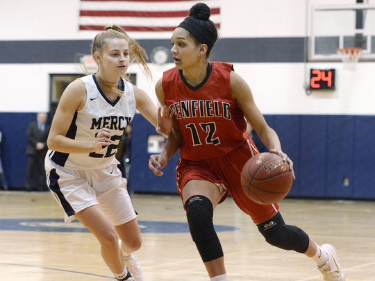 Penfield's Brianne Moxley, right, is defended by Mercy's Emily McDonough during a regular season game at Our Lady of Mercy High School on Monday, Feb. 5, 2018. Penfield beat Mercy 53-48. Moxley, a four-year starter, has signed a letter of intent to play at Queens College.