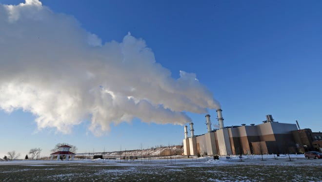 Steam rises from a We Energies plant in Port Washington.