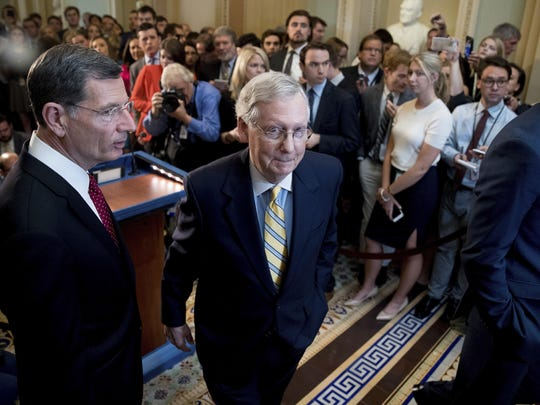 Senate Majority Leader Mitch McConnell (R-Ky.), joined by Sen. John Barrasso (R-Wyo.) (left), departs after announcing that he is delaying a vote on the Republican health care bill while the GOP leadership works toward getting enough votes, at the Capitol in Washington on June 27.