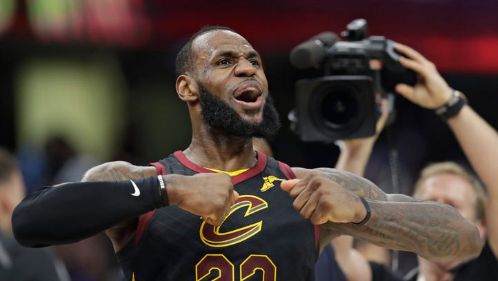 Cleveland Cavaliers' LeBron James celebrates after