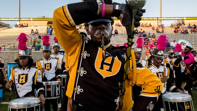 The Alabama State University marching hornets take the field before the Alcorn State game at Hornet Stadium on the ASU campus in Montgomery, Ala. on Thursday October 5, 2017.