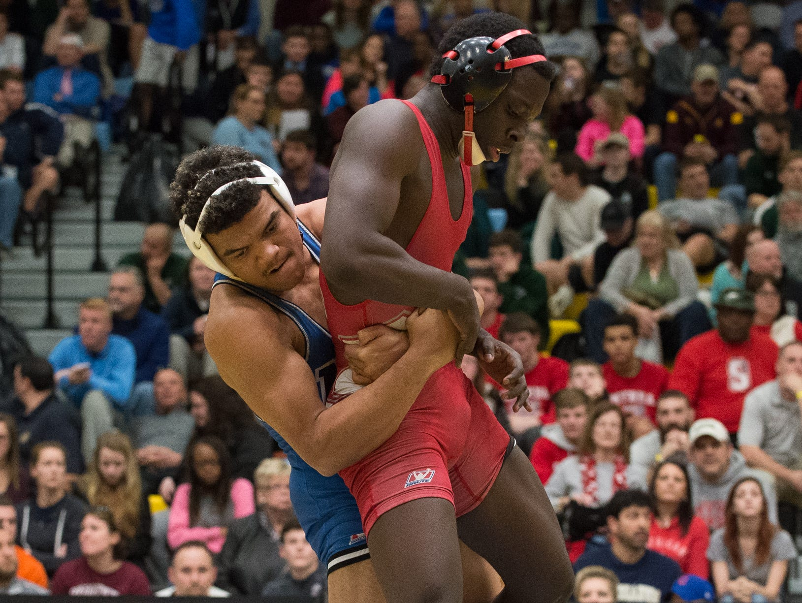 Middletown's Isiah Mitchell picks up Smyrna's Larsen Wilson in the 170 pound quarterfinals at the DIAA Individual State Tournament at Cape Henlopen High School.