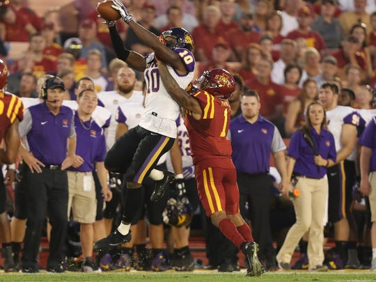 Northern Iowa Panthers wide receiver Daurice Fountain (10) makes a catch in front of Iowa State Cyclones defensive back D'Andre Payne (1) at Jack Trice Stadium.