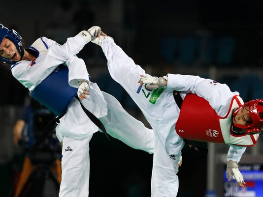 Kim Sohui from South Korea, right, competes with Tijana Bogdanovic from Serbia in the women's -49kg Taekwondo match at the Summer Olympics in Rio de Janeiro, Brazil, Wednesday, Aug. 17, 2016. (AP Photo/Vincent Thian)