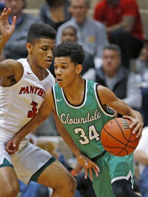 Cloverdale's #34 Jalen Moore moves past Park Tudor's #3 Isiah Moore during the Cloverdale vs Park Tudor basketball game of the Tip Off Classic at Southport Fieldhouse, Saturday, December 10, 2016.  Park Tudor won the game 74-63.