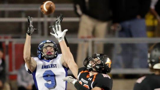Amherst High School's Josh Cisewski makes a catch for
