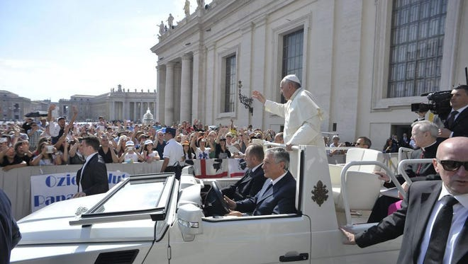 Pope Francis arrives Wednesday in his popemobile during his weekly general audience in St. Peter's Square at the Vatican.