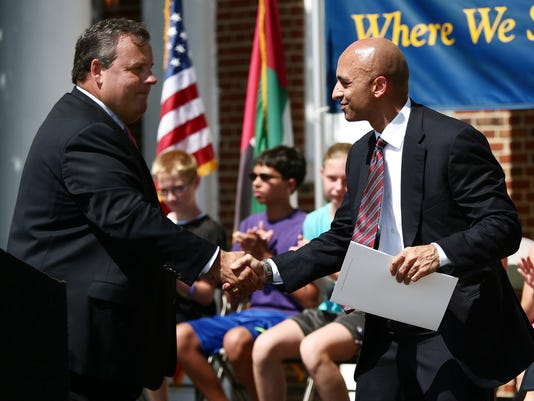 Gov. Chris Christie and United Arab Emirates Ambassador to the United States Yousef Al Otaiba shake hands after announcing a sizable donation by the UAE to the Hurricane Sandy New Jersey Relief Fund, on July 15, 2013 at Highlands Elementary School. (Governor's Office/Tim Larsen)