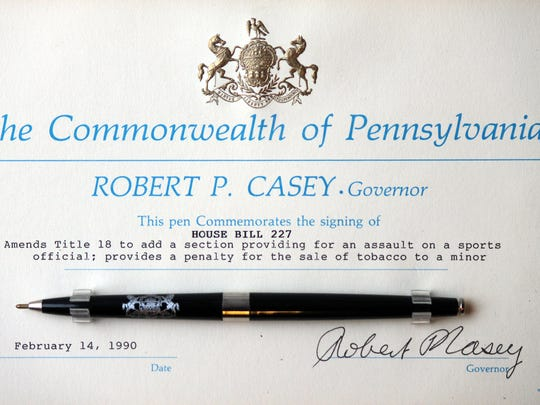 A certificate and pen commemorate the signing of House Bill 227, which put a law on the books in Pennsylvania called assault on a sports official. It carries a maximum sentence of 2 1/2 to five years in prison. Since 2006, three people in York County have been charged with the offense.
