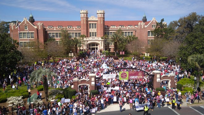 March for Our Lives protesters gather outside the Westcott building on Florida State's campus before marching to the Capitol to protest stricter gun control laws on Saturday, March 24.