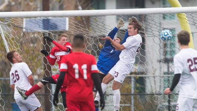 Newtown goalie Sam Miller tries but can't get to a corner kick by Bernards' Dan Paez during their Group II final on Sunday at Kean University.