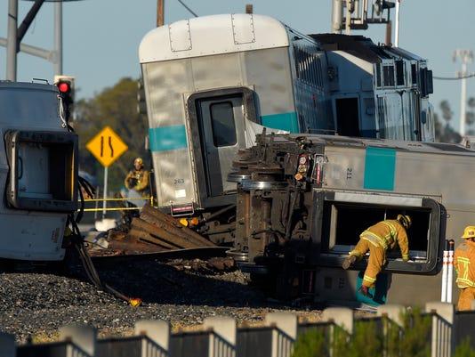 APTOPIX Train Truck Crash
