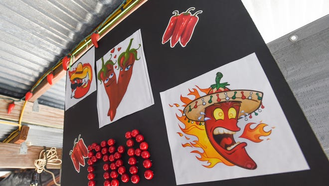 Donne' designs decorate the Hot Spot stand during the 2016 Mangilao Donne' Festival on Sept. 10.