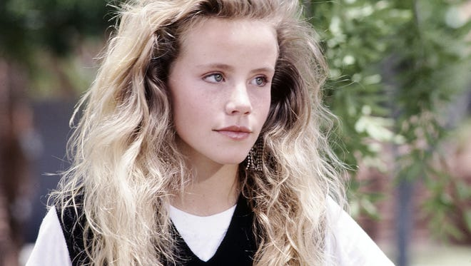 "File-This undated file photo provided by Disney shows actress Amanda Peterson in ""Can't Buy Me Love.""  The death of Peterson, best known for her role in the 1987 romantic comedy ""Can't Buy Me Love,"" was the result of an accidental morphine overdose. The autopsy and toxicology report released Wednesday, Sept. 2, 2015, by the Weld County Coroner's Office concluded that Peterson, 43, ingested a friend's morphine medication for unspecified pain a week before her death."