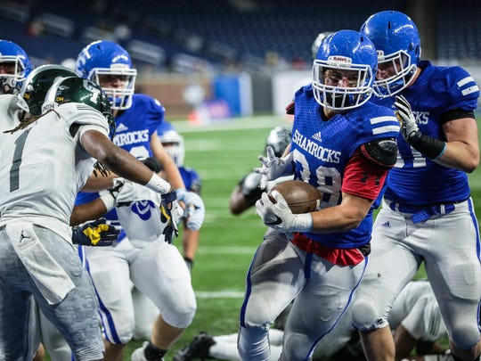 Catholic Central's Isaac Darkangelo goes in for the TD against Cass Tech.