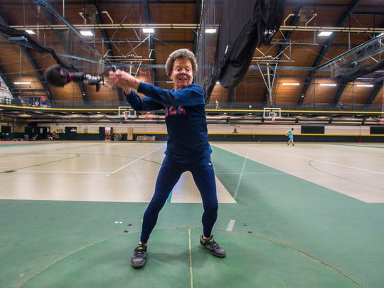 Flo Meiler, 82, of Shelburne, practices her hammer throw as she works out at the University of Vermont in Burlington on Monday, November 14, 2016.