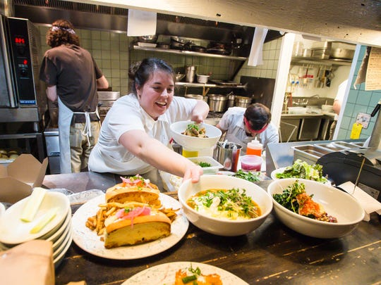 Chef Jaclyn Major makes room for more food coming out of the kitchen at Butch and Babe's in Burlington on Thursday, February 1, 2018.