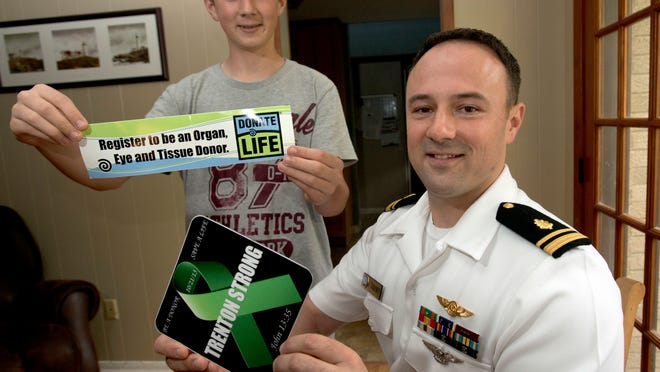 Navy Lt. j.g. Josh Faulkner, right, and his son Trenton, 15, left, have become ardent supporters of organ donation. Faulkner's 15-year-old son suddenly went into liver failure 18 months ago and received an emergency transplant, which saved his life.