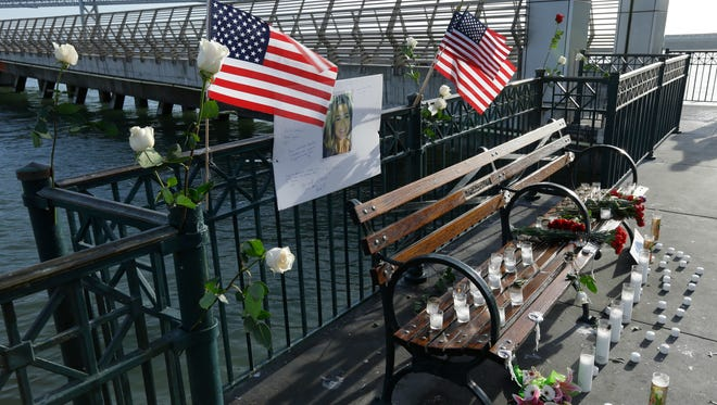Flowers and a portrait of Kate Steinle remain at a memorial site on Pier 14 on Friday in San Francisco.