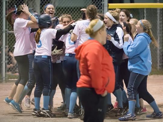 Livonia Stevenson softball players celebrate after