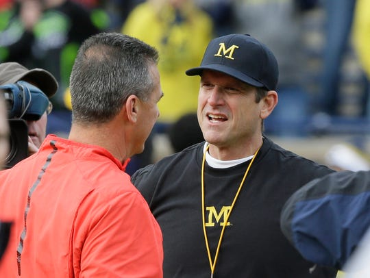 Ohio State coach Urban Meyer, left, meets with Michigan