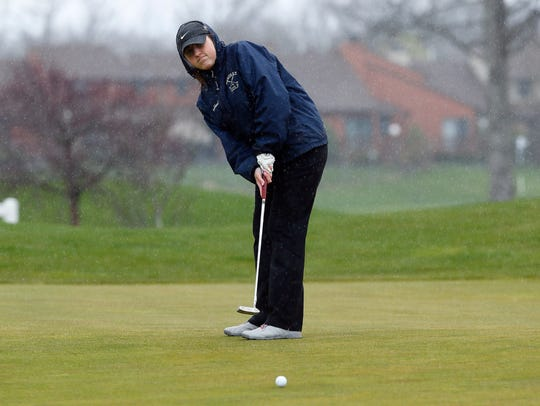 Mendham's Caroline Fischbach watches her putt during