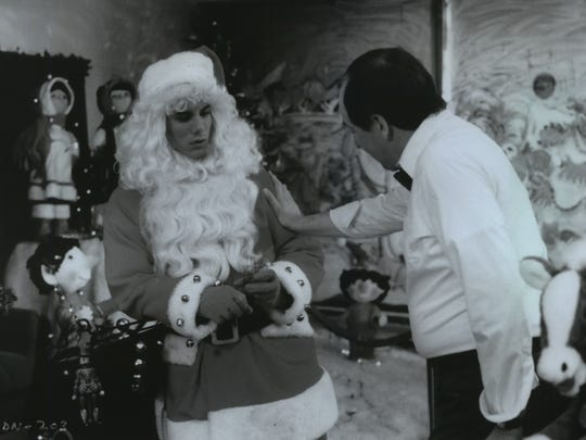 """A young man (Robert Brian Wilson) traumatized as a child by a killer in a Santa suit is forced to put on St. Nick's garb by his boss in the 1984 movie """"Silent Night, Deadly Night."""""""