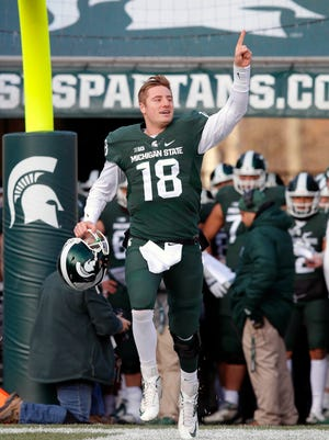 Michigan State quarterback Connor Cook runs onto the field as he is introduced on Senior Day against Penn State on Nov. 28, 2015, in East Lansing.