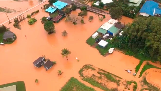 This April 15, 2018 image taken from video provided by the U.S. Coast Guard shows flooding along Kauai's Hanalei Bay, Hawaii. Hawaii Gov. David Ige issued an emergency proclamation for the island where heavy rainfall damaged or flooded dozens of homes in Hanalei, Wainiha, Haena and Anahola.