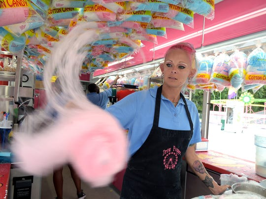 Kellie Donahoo makes cotton candy at the Williamson