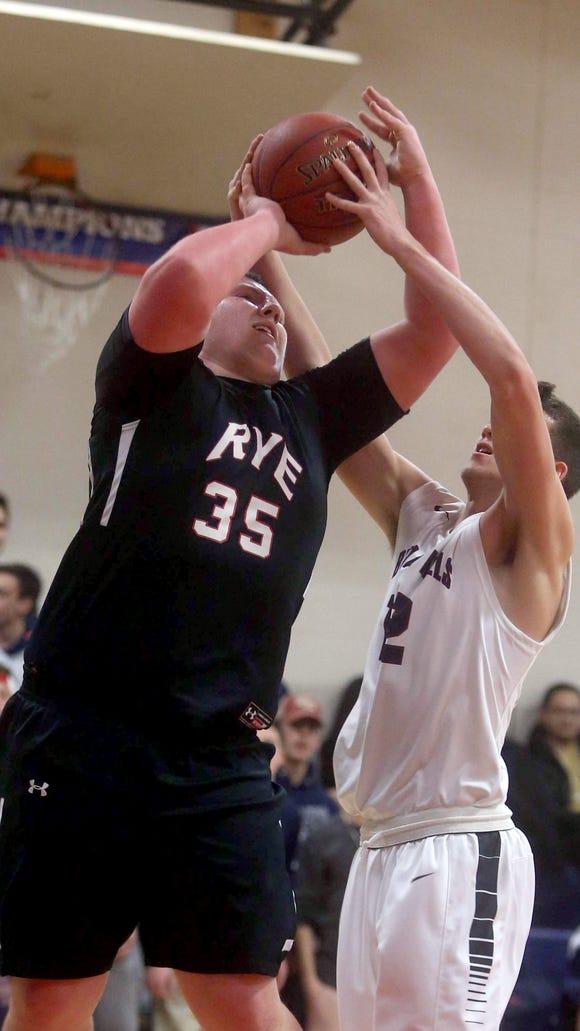 Ben Leff of Byram Hills blocks a shot by Rye's A.J.