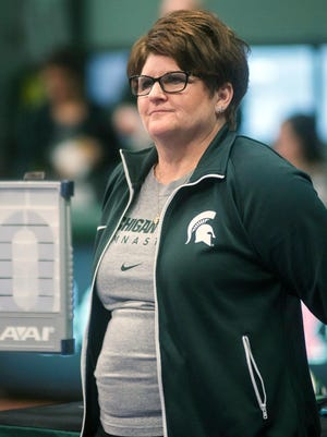 In this Feb. 13, 2015, photo, Michigan State University gymnastics head coach Kathie Klages watches the team during a meet in East Lansing. Klages resigned in February, a day after Michigan State University suspended her amid its internal investigations related to former MSU doctor Larry Nassar