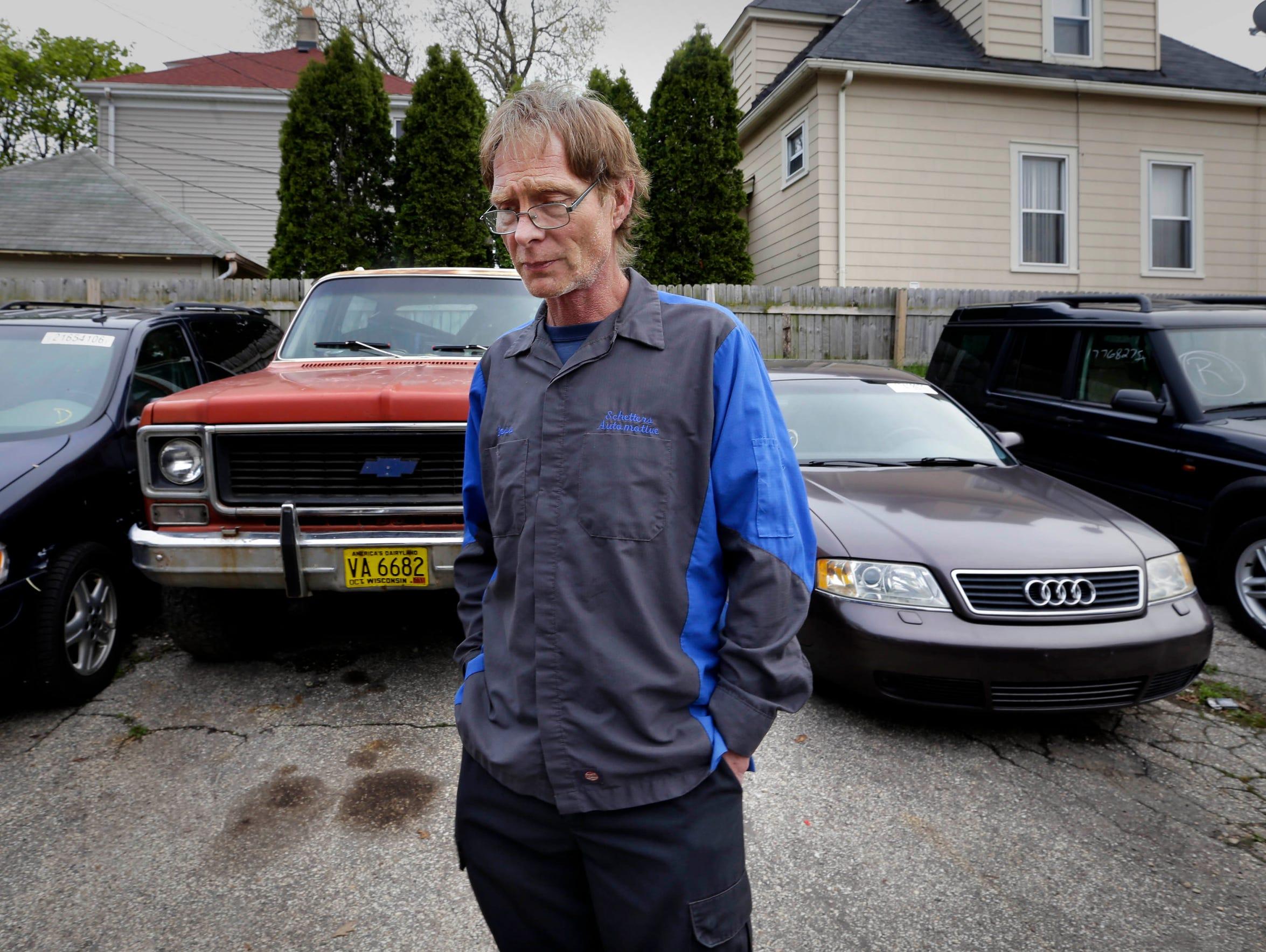 Ken Schetter, who owns an automotive repair shop in