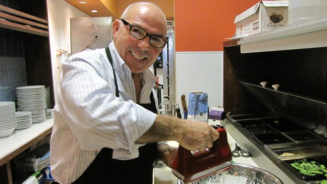 Antonio Durante whips mascarpone and cream for the tiramisu at his cafe and wine bar Caffe Toscano in south Fort Myers.