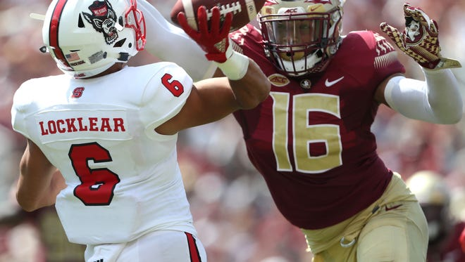 FSU's Jacob Pugh tries to block against NC State's Gavin Locklear during the Seminoles home opener at Doak Campbell Stadium on Saturday.