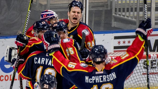 Rivermen defenseman Ben Oskroba, top, and his teammates celebrate their 2-1 win over Knoxville last season at Carver Arena. Oskroba on Wednesday announced his retirement.