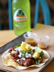 The Pork Pastor and Cheese from MexA Steak Tacos features