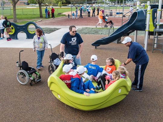 An all-inclusive playground in Ankeny featuring play structures that are accessible to kids with disabilities.