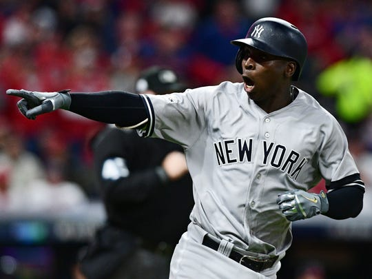 Yankees' Didi Gregorius points to the dugout after hitting a two-run home run off Cleveland Indians starting pitcher Corey Kluber during the third inning of Game 5 of a baseball American League Division Series, Wednesday, Oct. 11, 2017, in Cleveland. (AP Photo/David Dermer)