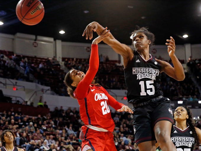 Mississippi State center Teaira McCowan (15) blocks