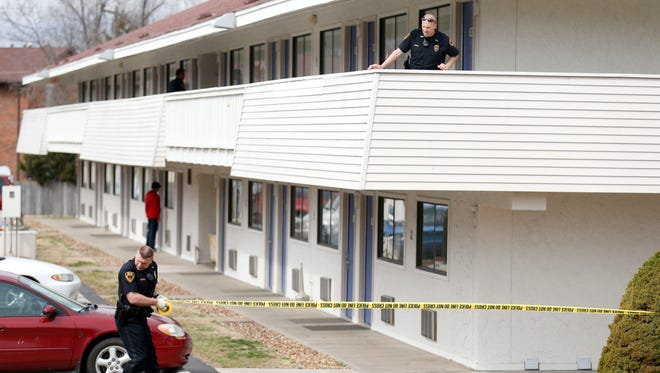 Springfield Police conduct a death investigation at a Motel 6 on north Glenstone Avenue on Tuesday, March 8, 2016.