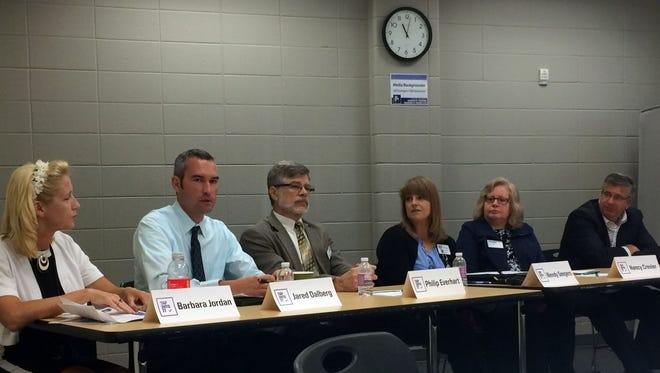Educators, medical professionals, social service leaders and lawmakers participate in a panel discussion on opioid abuse at the Greater Green Bay YMCA East Side Center in Bellevue on Tuesday, Sept. 20. Pictured from left: Barbara Jordan, behavioral health supervisor at the Brown County Community Treatment Center; Jared Dalberg, associate professor of health, exercise science and athletics at University of Wisconsin-Manitowoc; Phil Everhart, executive director of the Tri-City Area United Way in Marinette; Wendy Seegers, director of prevention programs for UW Colleges; Nancy Crevier, family living educator for UW-Extension in Marinette County; and State Rep. John Nygren of Marinette.
