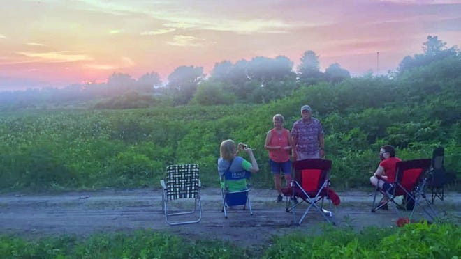 Linda Farris and her family set up on the Katy Trail Bridge over Interstate 70 on Saturday to watch the fireworks display set off at the Cooper County Fairgrounds. The fireworks were in front of the family while the full moon rose behind them, she wrote on Facebook.