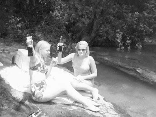 A young Debbie Fletcher and a friend show the bottles of Coca-Cola they would cool with the frigid waters of the Whitewater River.