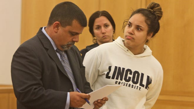 Nadia Figueroa of the Bronx reacts as she listens to the prosecutor make a case for $50,000 bail during her arraignment in Westchester County Court in September. On Thursday she was sentenced to two to six years in prison for her role in an identity-theft scheme.