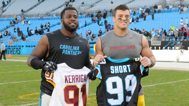 Fellow Boilermakers Kawann Short, left, and Ryan Kerrigan, right, exchange jerseys, Nov. 22, 2015.